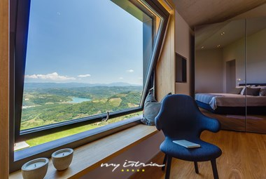 Amazing view through the window in one of the bedrooms in villa Vista in Central Istria