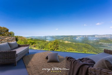 Comfy outdoor lounge area with spectacular view of the surrounding nature in villa Vista