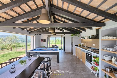 Outdoor kitchen with dining area and pool table in Villa Analucija