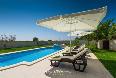 Enjoy the sun on the pool area of our villa in Istria