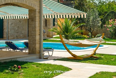 Hammock and sun loungers by the pool in stunning Villa Stonegate