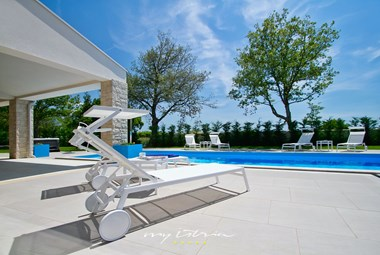 Sun loungers in the pool area of the villa