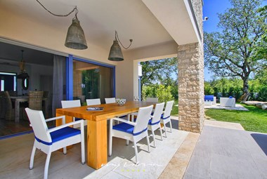 Spacious dining area on villa´s covered terrace