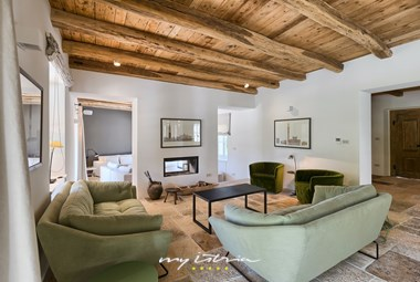 Romantic and cozy living room with warm wooden beams in villa Catalpa