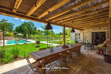 Outdoor eating area and mediterranean garden in villa in Porec