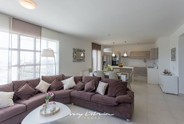 Open concept living room, kitchen and eating area in villa Mir