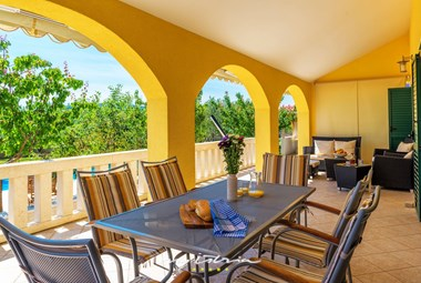covered terrace with dining and lounge area in Villa Mirjana