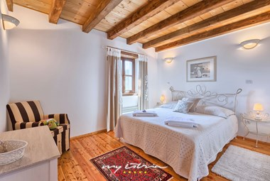 The romantic double bedroom with A/C and private bathroom on the upper floor of our holiday villa