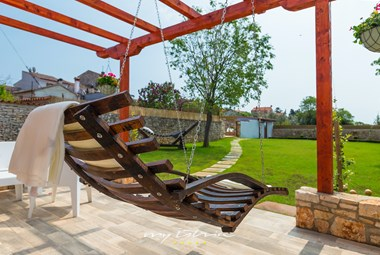 Inviting wooden hammock and lounge area overlooking the beautiful garden in Villa San Rocco