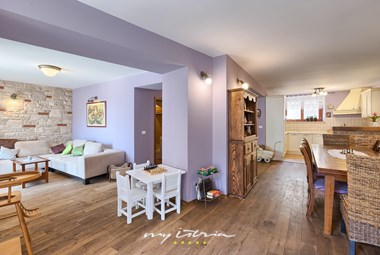 Cozy living room with pastel walls leading to the dining area and kitchen in Villa San Rocco