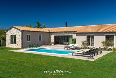 Charming Villa Grotte with sun loungers by the private pool and a beautiful carefully tended garden