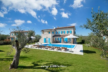 Divine villa with light blue shutters and private pool in a peaceful area