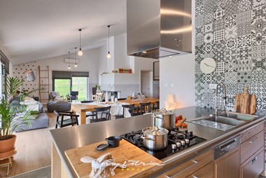 Modern kitchen with a cooking island on the ground floor of the villa