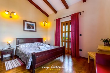 Lovely bedroom with double bed in the villa