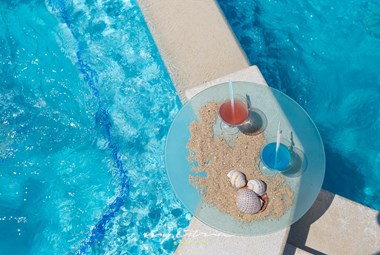 Relax and soak up the sun by the pool at Villa San Demich