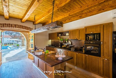 Beautiful kitchen with rustic details in Villa Dumina