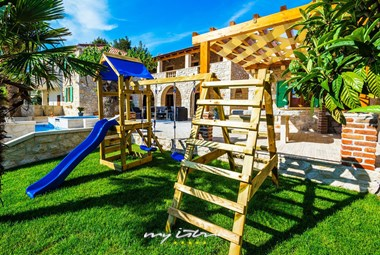 The private children's playground in our holiday villa near the sea