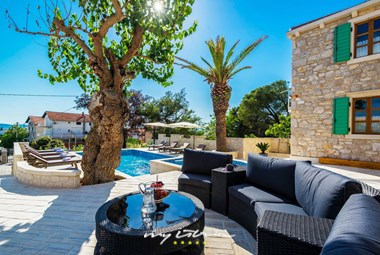 Enjoy on the cosy lounge in the pool area of the villa