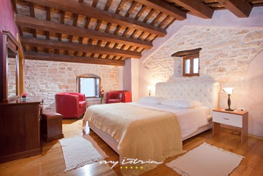 on of villa´s bedrooms with double bed