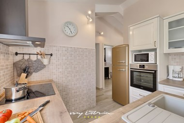 The villa has a fully equipped kitchen