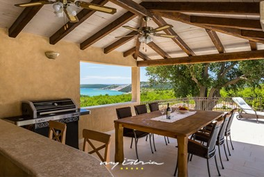 Beautiful dining area with barbecue in Villa Vlacich