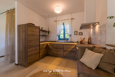 Fully equipped kitchen with dining area on the ground floor of the villa