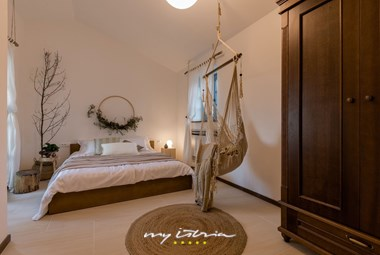 Cosy bedroom with double bed in the villa