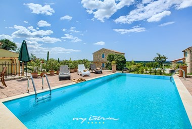 Relax on the sun loungers by the private pool in this beautiful villa near Umag and the sea