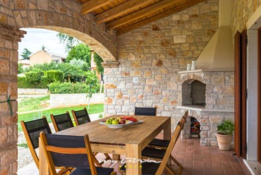 Villa has a terrace with dining area and charcoal barbecue