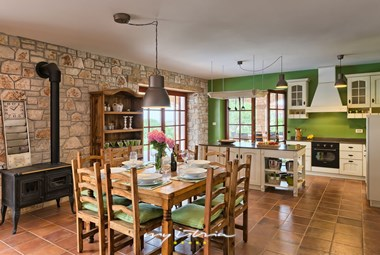 Beautifully decorated kitchen and dining area with rustic details in Villa Angelica