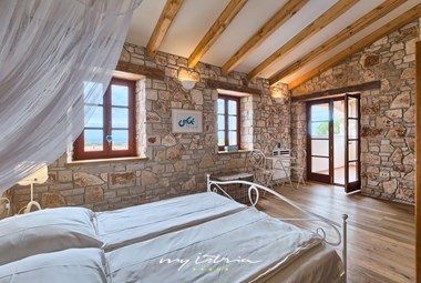 One of three bedrooms with ensuite bathroom in the villa