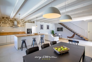 Modern spacious kitchen with a rustic touch on the ground floor of the villa