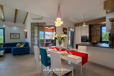 The remarkable dining area as part of the open plan living space in the villa