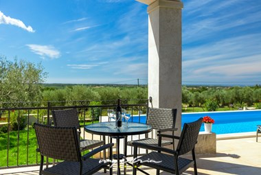 The villa has a terrace with view of the pool