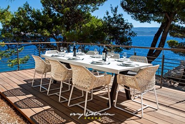 Outdoor dining area with a sea view