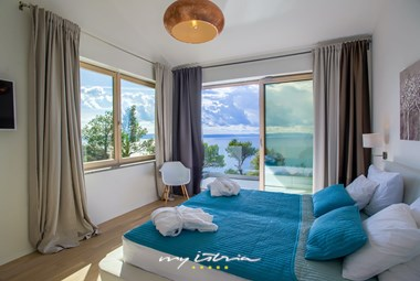 Bedroom with double bed and a view in Villa Yanko
