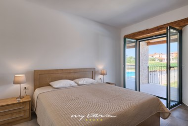 One of the cosy bedrooms in Villa Pomer