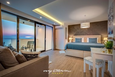 Contemporary designed bedroom with stunning view from the villa