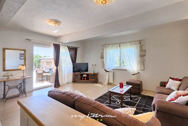 Large spacious living room with access to the outside terrace of the villa