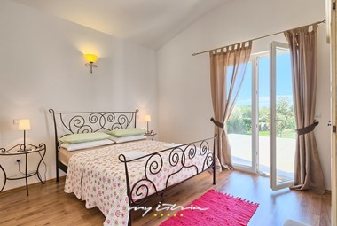 One of five beautifully furnished bedrooms in the villa