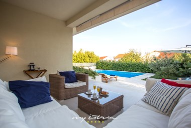 A cosy terrace next to the pool and the lovely garden that surrounds the villa