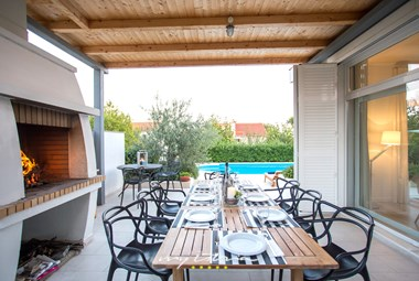 Barbecue and outdoor dining area will make your stay in this villa complete