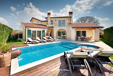 Inviting pool area in Villa Labinci with relaxing sun loungers