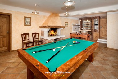 Tavern in the villa equipped with a pool table and table football