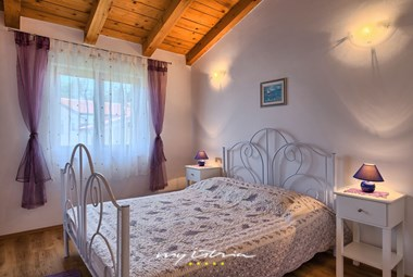 Bedroom with double bed in Villa in Istria