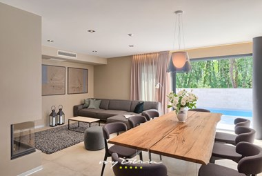 Luxurious living and dining area with sliding balcony doors in villa in Umag