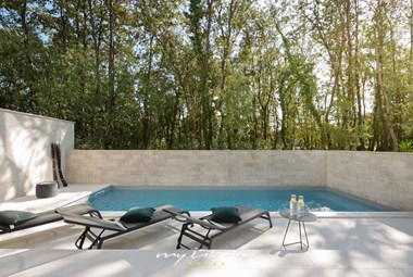 Take a swim in the gorgeous pool of Villa Oliva 1