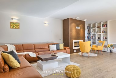 Bright and modern living area with fireplace in Villa Baladur