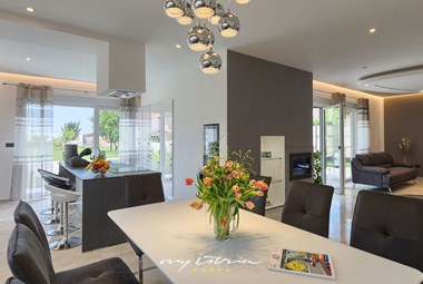 Luxurious dining table and kitchen in Villa Kiasy