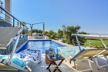 Sun loungers in front of villa´s private pool